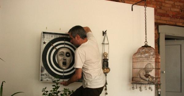 Jonathan Hanging Susan Moloney's Work - The Slingluff Gallery